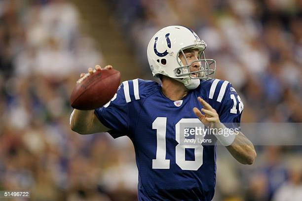 Quarterback Peyton Manning of the Indianapolis Colts looks for an open receiver during the game against the Oakland Raiders at the RCA Dome on...
