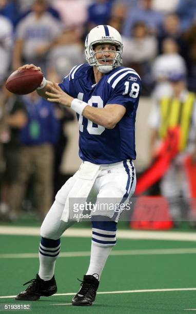 Quarterback Peyton Manning of the Indianapolis Colts passes the ball in the first quarter against the Denver Broncos during the AFC Wildcard playoff...