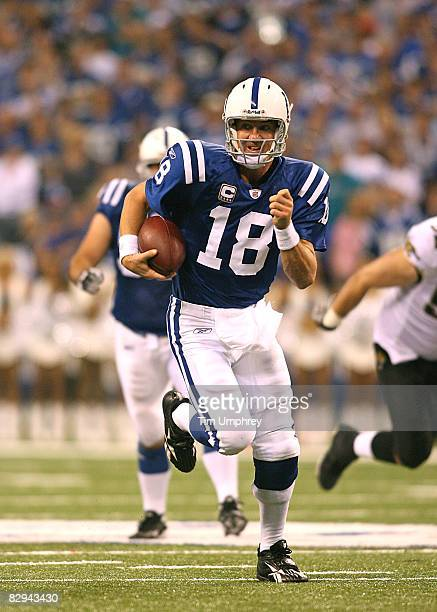 Quarterback Peyton Manning of the Indianapolis Colts runs down field in a game against the Jacksonville Jaguars at Lucas Oil Stadium on September 21,...