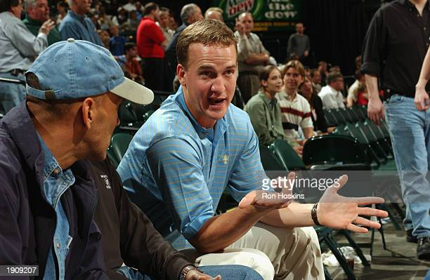 Quarterback Peyton Manning of the Indianapolis Colts talks to his head coach Tony Dungy as the Indiana Pacers host the Sacramento Kings at Conseco...