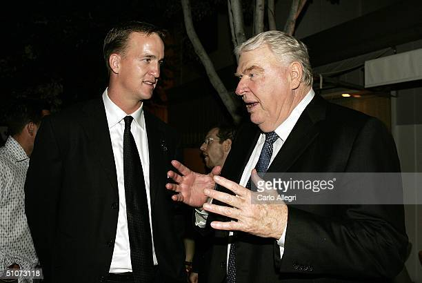 Quarterback Peyton Manning of the Indianapolis Colts talks with TV personality John Madden at the 2004 ESPY Awards after party at the Mondrian Hotel...