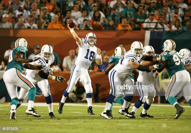 Quarterback Peyton Manning of the Indianapolis Colts throws a touchdown pass to tight end Dallas Clark on the first play from scrimmage against the...