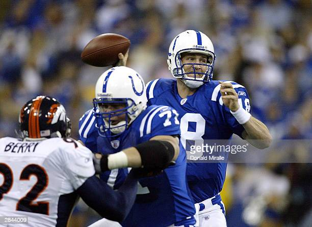 Quarterback Peyton Manning of the Indianapolis Colts throws against the defense of the Denver Broncos in their AFC Playoff Game on January 4 2004 at...