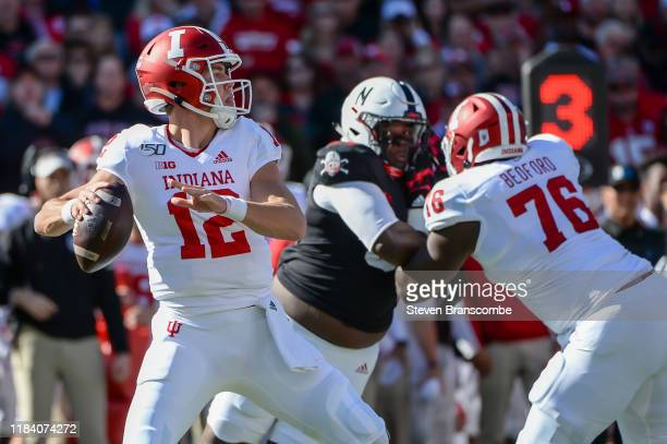 Quarterback Peyton Ramsey of the Indiana Hoosiers drops back to pass against the Nebraska Cornhuskers at Memorial Stadium on October 26 2019 in...