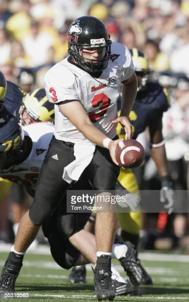 Quarterback Phil Horvath of the Northern Illinois Huskies looks to hand off the ball during the game against the Michigan Wolverines at Michigan...