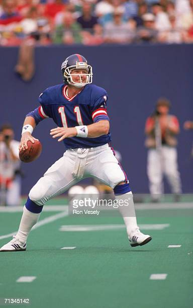 Quarterback Phil Simms of the New York Giants attempts to pass the ball against the San Francisco 49ers during the game on September 11 1988 at...
