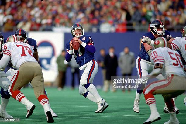 Quarterback Phil Simms of the New York Giants drops back to pass during a playoff game against the San Francisco 49ers at Giants Stadium on January 4...
