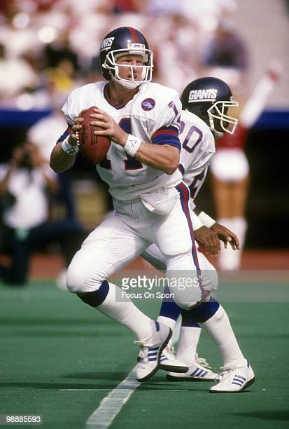 Quarterback Phil Simms of the New York Giants drops back to pass circa 1986 during an NFL football game Simms played for the Giants from 197993