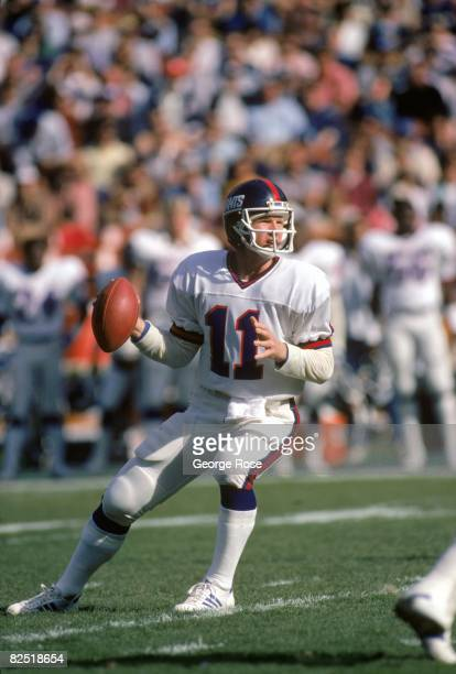 Quarterback Phil Simms of the New York Giants drops back to pass during the 1984 NFC Wild Card game against the Los Angeles Rams at Anaheim Stadium...