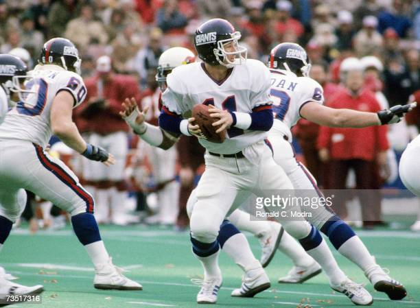 Quarterback Phil Simms of the New York Giants goes back to pass against the St Louis Cardinals on December 9 1984 in St Louis Missouri