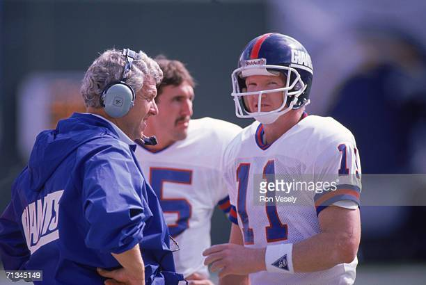 Quarterback Phil Simms of the New York Giants talks to his head coach Bill Parcells during the game against the San Diego Chargers on October 22 1989...