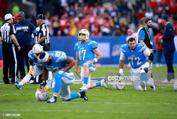 Quarterback Philip Rivers of the Los Angeles Chargers and team warmup before the game against the Kansas City Chiefs at Estadio Azteca on November 18...