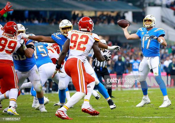 Quarterback Philip Rivers of the Los Angeles Chargers delivers a pass over the defense of the Kansas City Chiefs during the game at Estadio Azteca on...