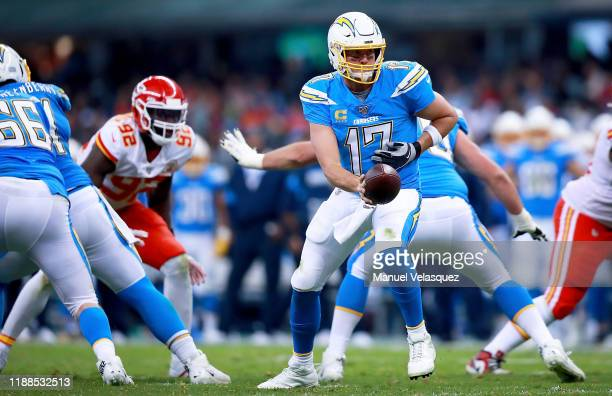 Quarterback Philip Rivers of the Los Angeles Chargers hands off the ball during the game against the Kansas City Chiefs at Estadio Azteca on November...
