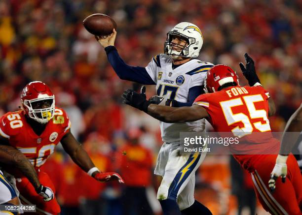 Quarterback Philip Rivers of the Los Angeles Chargers is hit by outside linebacker Dee Ford of the Kansas City Chiefs during the game at Arrowhead...