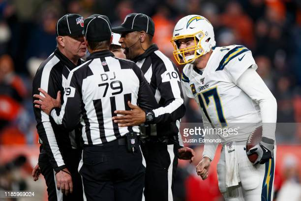 Quarterback Philip Rivers of the Los Angeles Chargers listens in as the referees discuss a false start penalty on the Chargers in the fourth quarter...