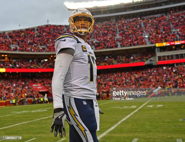 Quarterback Philip Rivers of the Los Angeles Chargers looks on from the sideline against the Kansas City Chiefs during the second half at Arrowhead...