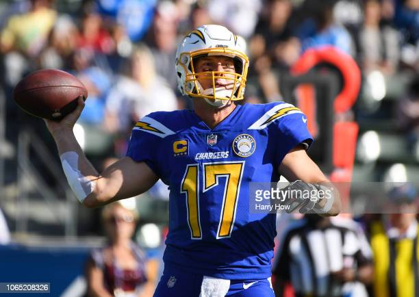 Quarterback Philip Rivers of the Los Angeles Chargers passes in the first quarter against the Arizona Cardinals at StubHub Center on November 25 2018...