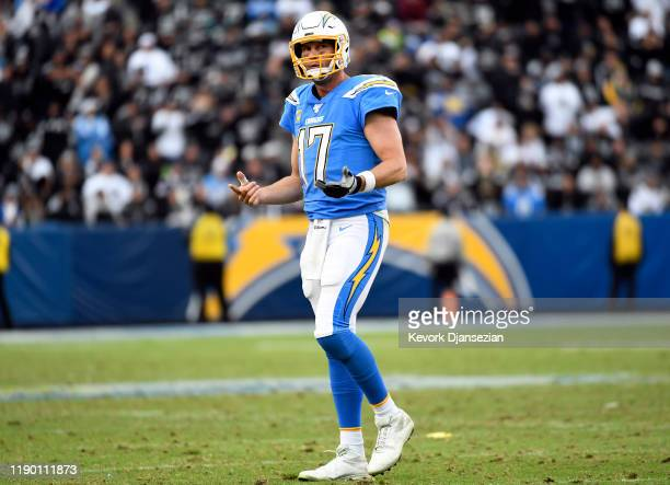 Quarterback Philip Rivers of the Los Angeles Chargers reacts after throwing an incomplete pass against the Oakland Raiders late in the second half at...