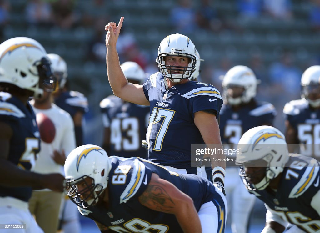 Quarterback Philip Rivers #17 of the Los Angeles Chargers warms up before the start of their pre season football game against the Seattle Seahawks at StubHub Center August 13, 2017, in Carson, California.