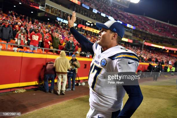 Quarterback Philip Rivers of the Los Angeles Chargers waves to Kansas City Chiefs fans after the Chargers defeated the Chiefs with a final score of...