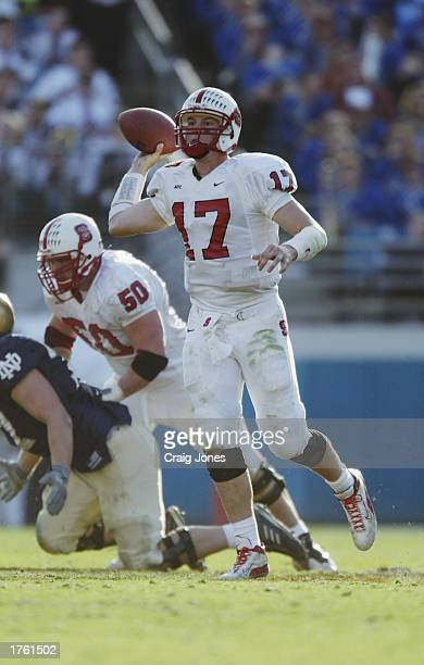 Quarterback Philip Rivers of the North Carolina State University Wolfpack throws a pass against the Notre Dame Fighting Irish in the Toyota Gator...