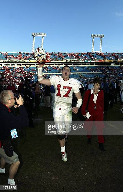 Quarterback Philip Rivers of the North Carolina State University Wolfpack celebrates the victory over the Notre Dame Fighting Irish in the Toyota...