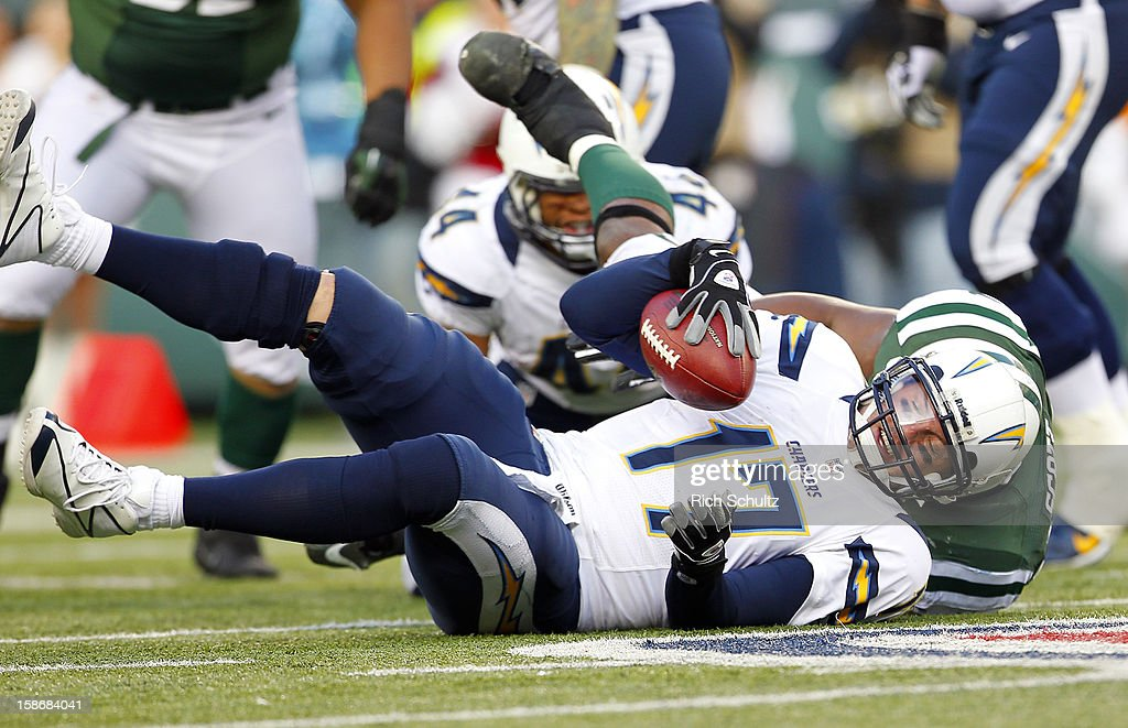 Quarterback Philip Rivers #17 of the San Diego Chargers is sacked by Bart Scott #57 of the New York Jets during the second half at MetLife Stadium on December 23, 2012 in East Rutherford, New Jersey. The Chargers defeated the Jets 27-17.