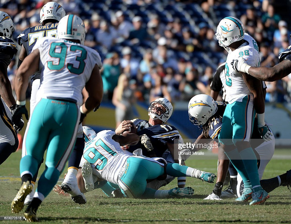 Quarterback Philip Rivers #17 of the San Diego Chargers is sacked in the second half by the Miami Dolphins at Qualcomm Stadium on November 13, 2016 in San Diego, California. He had 4 interceptions on the day during their 31-24 loss.
