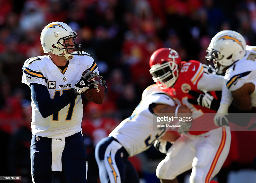 Quarterback Philip Rivers #17 of the San Diego Chargers looks to pass during the game against the Kansas City Chiefs at Arrowhead Stadium on December 28, 2014 in Kansas City, Missouri.