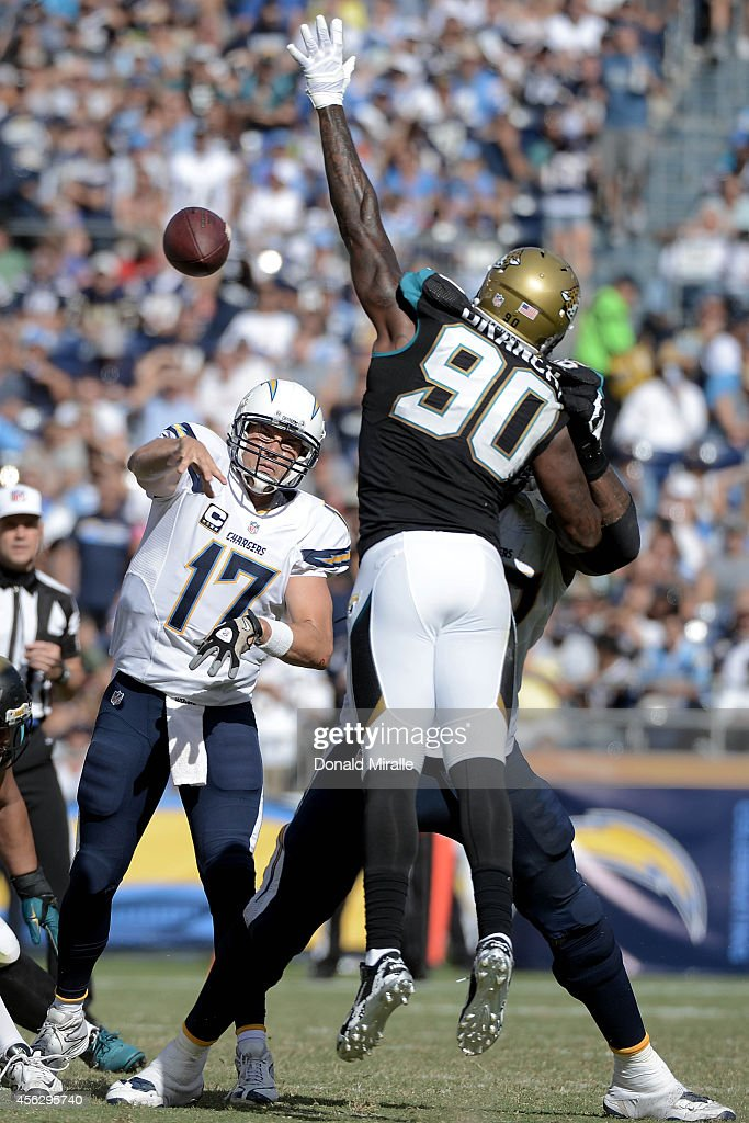 Quarterback Philip Rivers #17 of the San Diego Chargers passes under pressure during a 33-14 win over the Jacksonville Jaguars in their NFL game at Qualcomm Stadium on September 28, 2014 in San Diego, California.