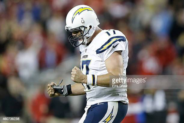 Quarterback Philip Rivers of the San Diego Chargers reacts after throwing a fourth quarter touchdown pass to wide receiver Malcom Floyd against the...