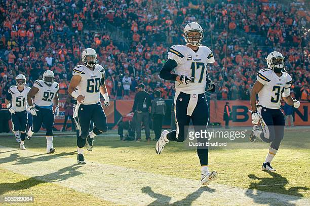 Quarterback Philip Rivers of the San Diego Chargers runs out onto the field among teammates including Kyle Emanuel Ryan Carrethers Trevor Robinson...
