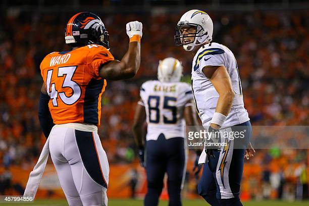 Quarterback Philip Rivers of the San Diego Chargers yells near strong safety TJ Ward of the Denver Broncos at Sports Authority Field at Mile High on...