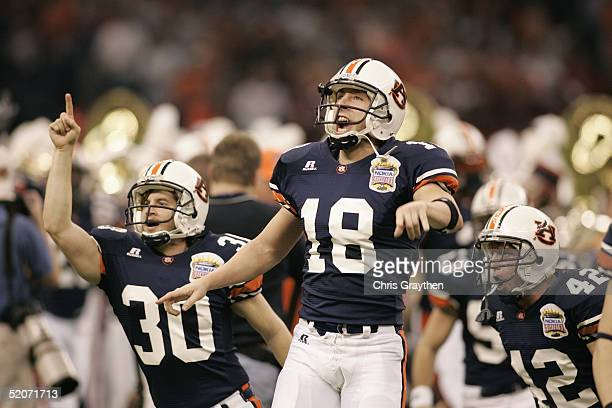 Quarterback Philip Yost wide receiver Maurice Anderson and safety Bret Holliman of the Auburn Tigers celebrate after defeating the Virginia Tech...