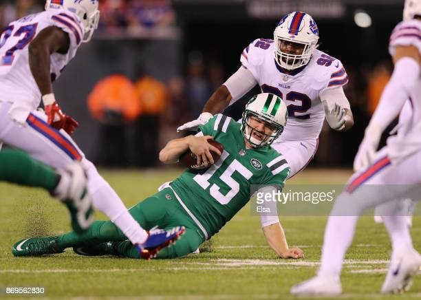 Quarterback quarterback Josh McCown of the New York Jets scrambles with the ball to get a firstdown against the Buffalo Bills during the first...