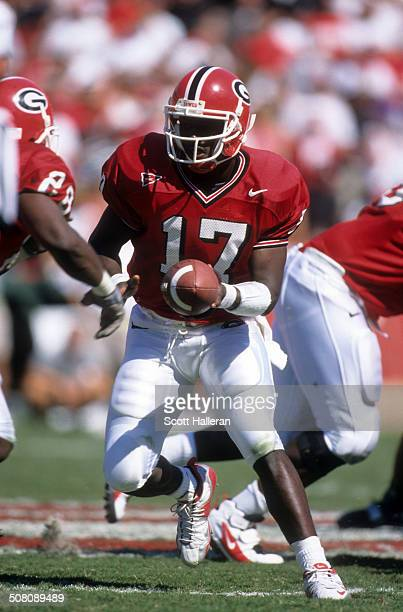 Quarterback Quincy Carter of the Georgia Bulldogs looks to handoff during the game against the LSU Tigers on October 2 1999 at Sanford Stadium in...