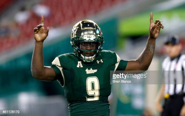 Quarterback Quinton Flowers of the South Florida Bulls celebrates following his 1 yard rushing touchdown during the fourth quarter of an NCAA...