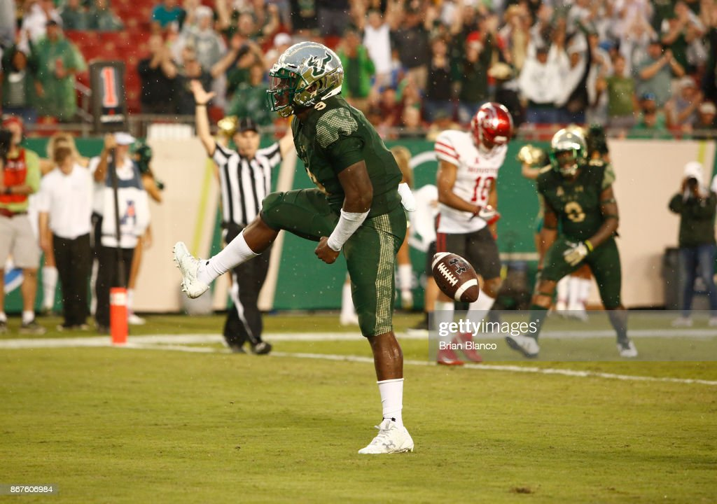 Quarterback Quinton Flowers #9 of the South Florida Bulls celebrates his 1-yard touchdown run in the end zone during the fourth quarter of an NCAA football game against the Houston Cougars on October 28, 2017 at Raymond James Stadium in Tampa, Florida.
