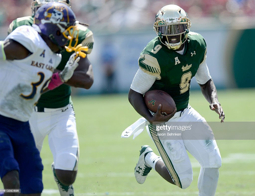 Quarterback Quinton Flowers #9 of the South Florida Bulls gains yards against the East Carolina Pirates during the 2nd quarter at Raymond James Stadium on October 8, 2016 in Tampa, Florida.