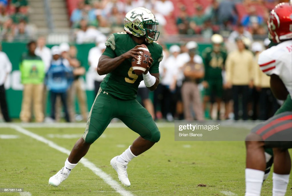 Quarterback Quinton Flowers #9 of the South Florida Bulls looks for an open receiver during the first quarter of an NCAA football game against the Houston Cougars on October 28, 2017 at Raymond James Stadium in Tampa, Florida.