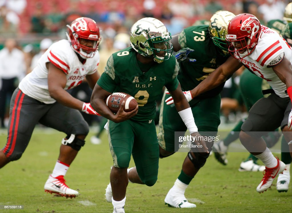 Quarterback Quinton Flowers #9 of the South Florida Bulls runs for several yards during the first quarter of an NCAA football game against the Houston Cougars on October 28, 2017 at Raymond James Stadium in Tampa, Florida.