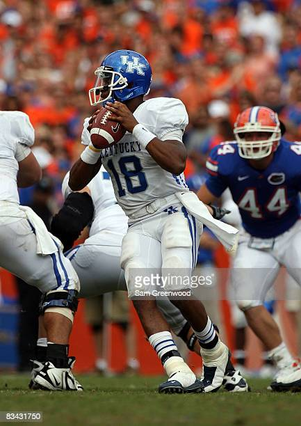 Quarterback Randall Cobb of the Kentucky Wildcats drops back to pass in a game against the Florida Gators at Ben Hill Griffin Stadium on October 25...