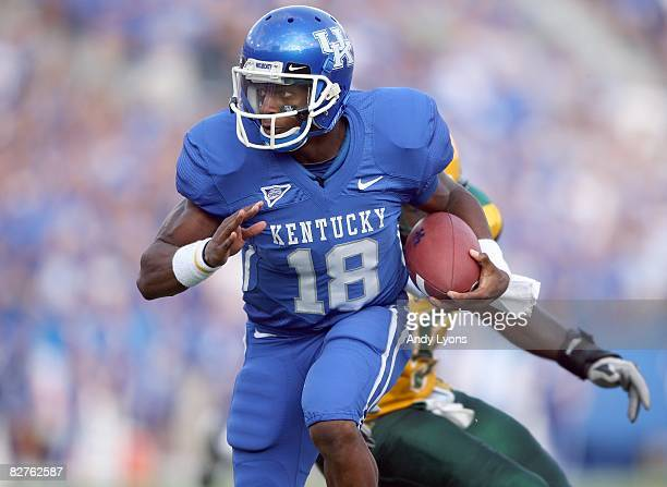 Quarterback Randall Cobb of the Kentucky Wildcats runs with the ball during the game against the Norfolk State Spartans at Commonwealth Stadium on...
