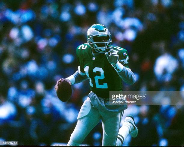 Quarterback Randall Cunningham of the Philadelphia Eagles sets up to pass against the Dallas Cowboys at Texas Stadium in the 1995 NFC Divisional...