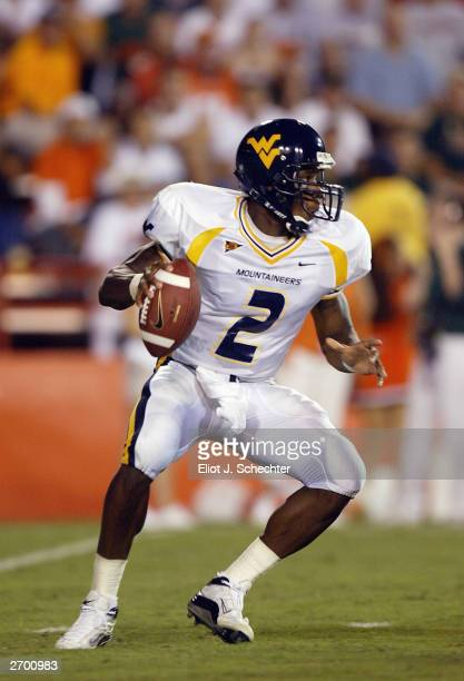 Quarterback Rasheed Marshall of the West Virgina Mountaineers drops back to pass against the University of Miami Hurricanes October 2 2003 at The...