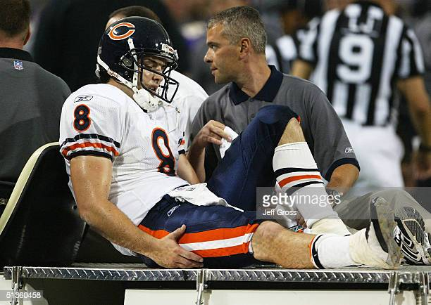Quarterback Rex Grossman of the Chicago Bears leaves the game on a cart after sustaining a right leg injury against the Minnesota Vikings on...