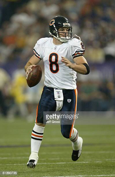 Quarterback Rex Grossman of the Chicago Bears looks to pass during a game against the Minnesota Vikings at the Hubert H Humphrey Metrodome on...