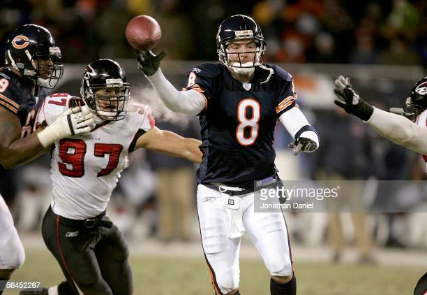 Quarterback Rex Grossman of the Chicago Bears throws a pass under pressure from Patrick Kerney of the Atlanta Falcons on December 18 2005 at Soldier...