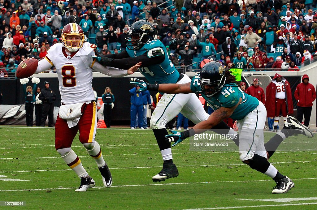 Quarterback Rex Grossman #8 of the Washington Redskins is pressured by Austen Lane #92 and Jeremy Mincey #94 of the Jacksonville Jaguars during the game at EverBank Field on December 26, 2010 in Jacksonville, Florida.